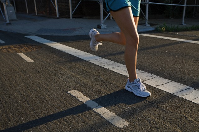 Legs of runner on road