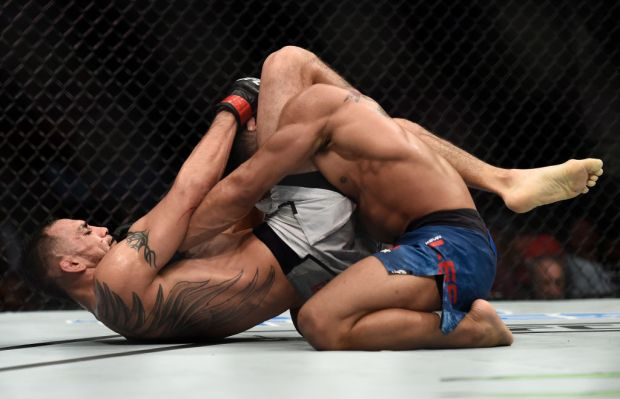 LAS VEGAS, NV - OCTOBER 07:   Tony Ferguson secures a triangle choke submission to defeat Kevin Lee in their interim UFC lightweight championship bout during the UFC 216 event inside T-Mobile Arena on October 7, 2017 in Las Vegas, Nevada. (Photo by Brandon Magnus/Zuffa LLC/Zuffa LLC via Getty Images)