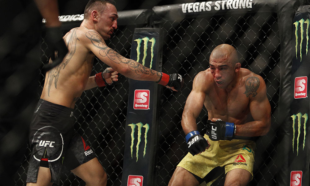Dec 2, 2017; Detroit, MI, USA; Max Holloway (red gloves) fights Jose Aldo (blue gloves) during UFC 218 at Little Caesars Arena. Mandatory Credit: Raj Mehta-USA TODAY Sports